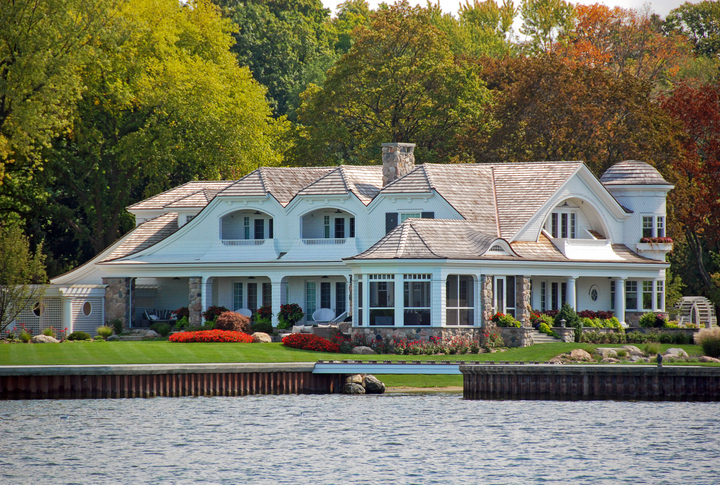 Large white summer home on the lake